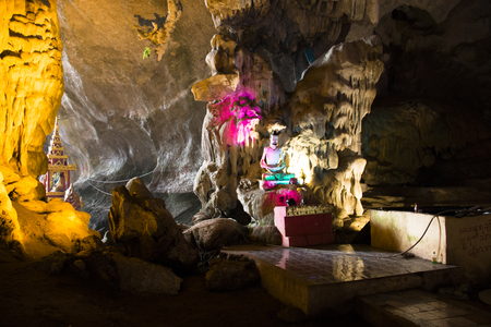 Religious statues in the Sadan cave near Hpa-An in Myanmar Фото со стока - 120168070