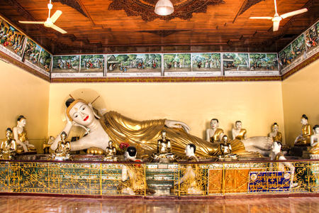 The impressive golden Shwedagon Pagoda is one of the most famous temples in Yangon, the capital of Myanmar Редакционное