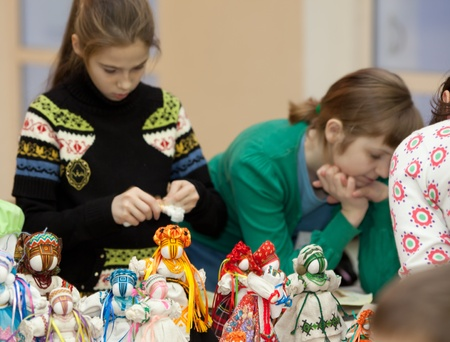 Children make puppets from cloth. Doll - motanka.  Charity marathon From Andrew to Nicholas,  December 12-18, 2011,  Lviv, Ukraine