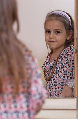 görüntü: Portrait of little girl. Reflection in the mirror.
