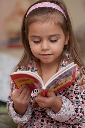 Portrait of little girl with a book
