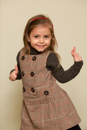 Portrait of little girl in funny dance pose photo