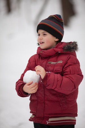 Boy have winter fun with snowball fight  outdoor Stock Photo - 12510839