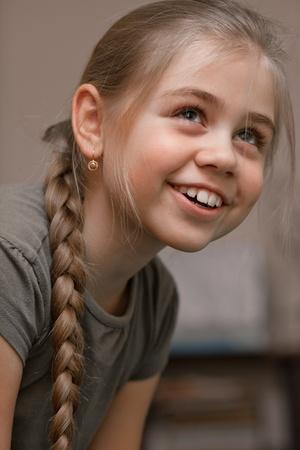 Beautiful smiling girl, hair braided Stock Photo