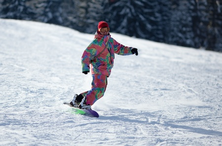 Man snowboarding down the slope photo