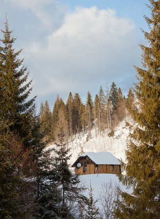 Winter hut in mountain landscape  photo