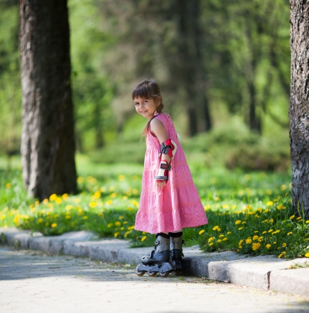 Adorable little girl gains confidence on her rollerblades photo