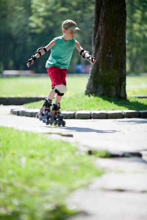 Little boy skating in the park photo