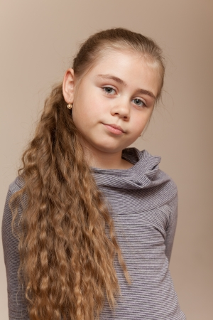 Portrait of a beautiful girl with very long curly hair looking at camera photo