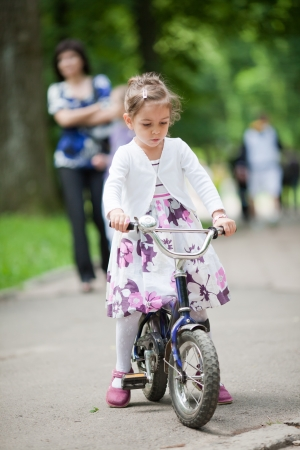 Cute 4 year old little girl enjoying her bike photo