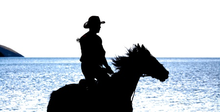 like looking silhouette of cowboy sitting on a horse  Good for vectorising  Sea background  photo
