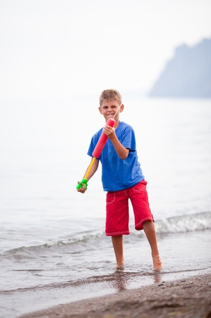 A child playing with his water gun photo