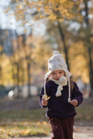 Portrait of little girl with knit hat and scarf Stock Photo - 15469182
