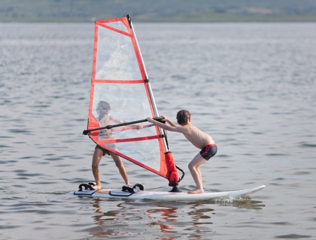7 8 years: Two little boys go windsurfing in unusual way