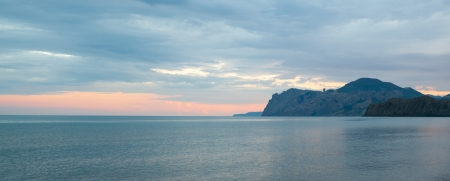 Beautiful view of the Black sea coast.  Karadag, Crimea, Ukraine. Evening light. photo
