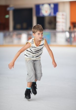 Ice skating little boy