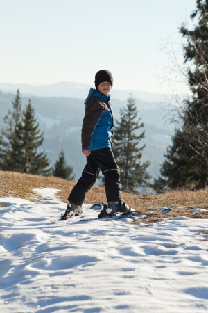 Skiing in the mountain in warm weather, snow already melting photo