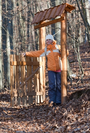 non urban 1: Cute woman and mysterious gate in the forest
