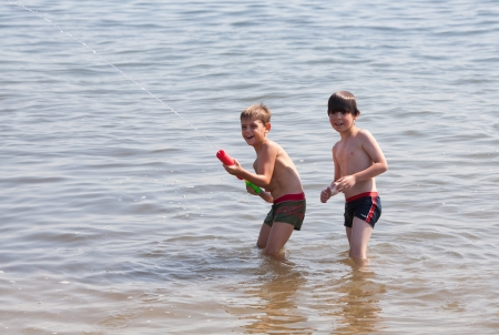 Boys playing with water gun photo