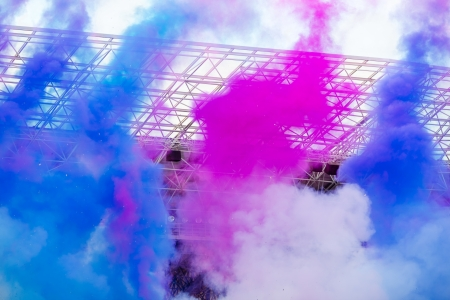 showmanship: Colored smoke on concert in the stadium
