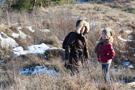 two girls: Mother with daughter on the hill in winter park Stock Photo