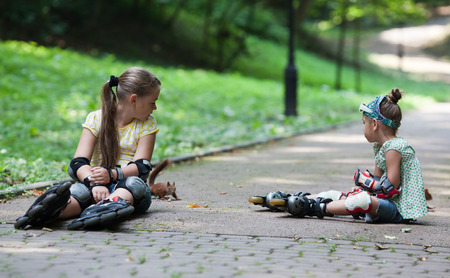 roller blade: Two little girls with roller blade at park