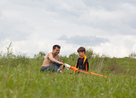 preadolescence: Father and son are preparing an equipment for a windsurfing