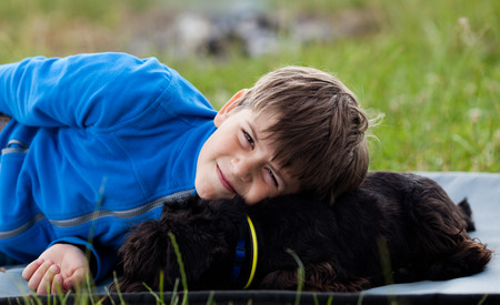 Portrait of happy young boy with his friendly pet