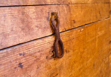 Old wooden chest with metal lock. Close up photo