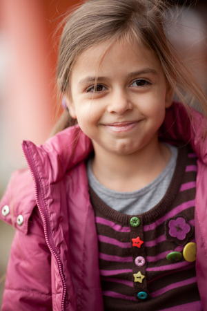 closeup portrait: Close up of a seven year old beautiful girl smiles Stock Photo