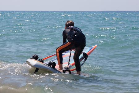 Little boy starting the windsurfing photo
