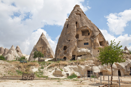 Rugged rock formations riddled with ancient cave houses near Goreme, Cappadocia, Turkey. Close up Stock Photo