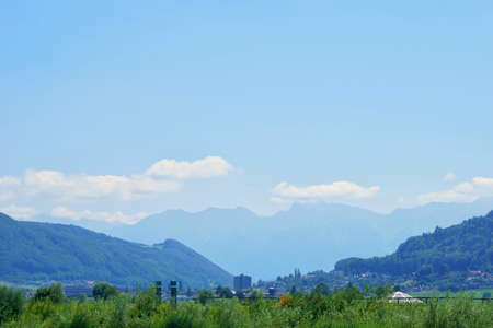 beautiful landscape view of the aare river and the mountains in the distance