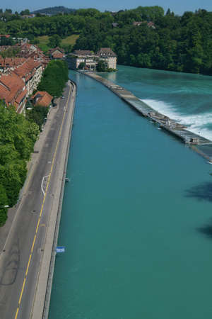 the beautiful view of the city center and the aare river from the Kornhausbrücke bridge in bern, switzerland