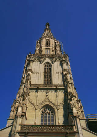the beautiful view of the Berner münster cathedral tower in the city center of Bern, Switzerland