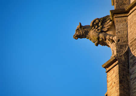 beautiful gargoyle on a church  at the old town city center in Heidelberg, Germany