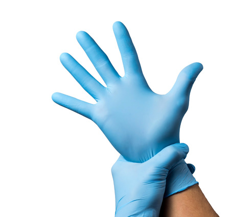 Doctor putting on protective gloves, isolated on white.