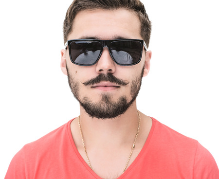 close up picture of a casual young man with beard, looking into the camera. on white studio background.