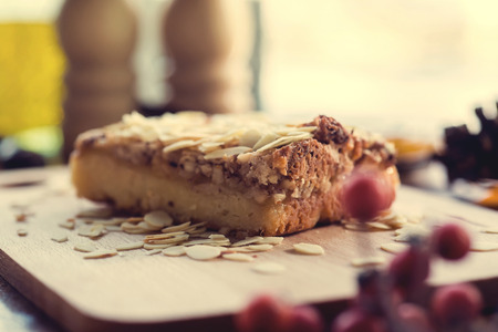 Pieces of apple pie decorated on wooden table. photo