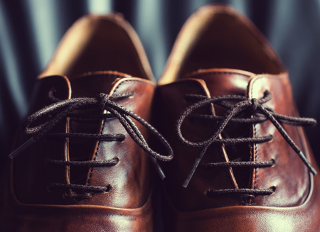 Close up of brown leather mens shoes.