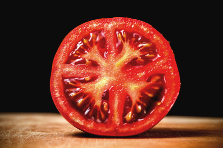 half  cut: Half Cut Sliced of Fresh Tomato on Wood Table Background