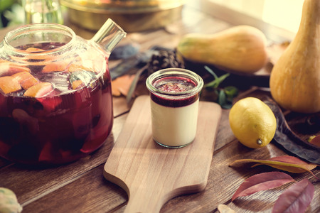 Traditional Italian dessert panna cotta with raspberries and red fruit tea with orange and lemon. Stock Photo