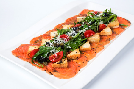 rucola: Appetizer - Salmon Carpaccio with Parmesan Cheese and Rucola. Stock Photo