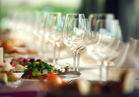 fine dining: Close up picture of empty glasses in restaurant. Selective focus. Stock Photo