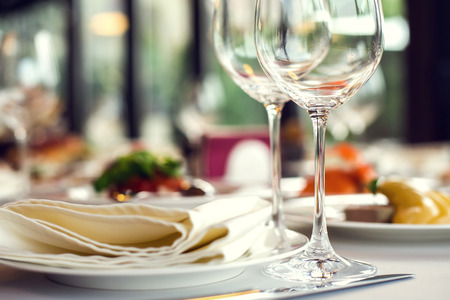 banquet table: Close up picture of empty glasses in restaurant. Selective focus. Stock Photo