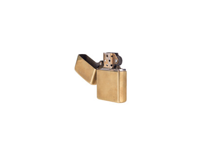 pyro: classic brass metal lighter isolated on white.