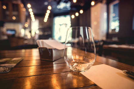 restaurant setting: Close up picture of empty glasses in restaurant.