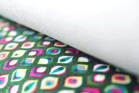 vibrant background: Rolls of colorful fabric as a vibrant background image. Stock Photo