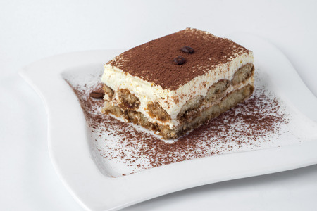 tiramisu cake isolated on white background.