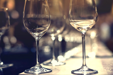 dining table: Close up picture of empty glasses in restaurant. Selective focus. Stock Photo